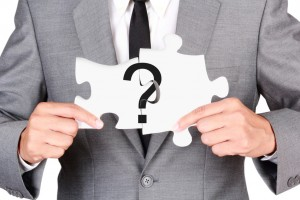 Businessman showing jigsaw connect create question mark
