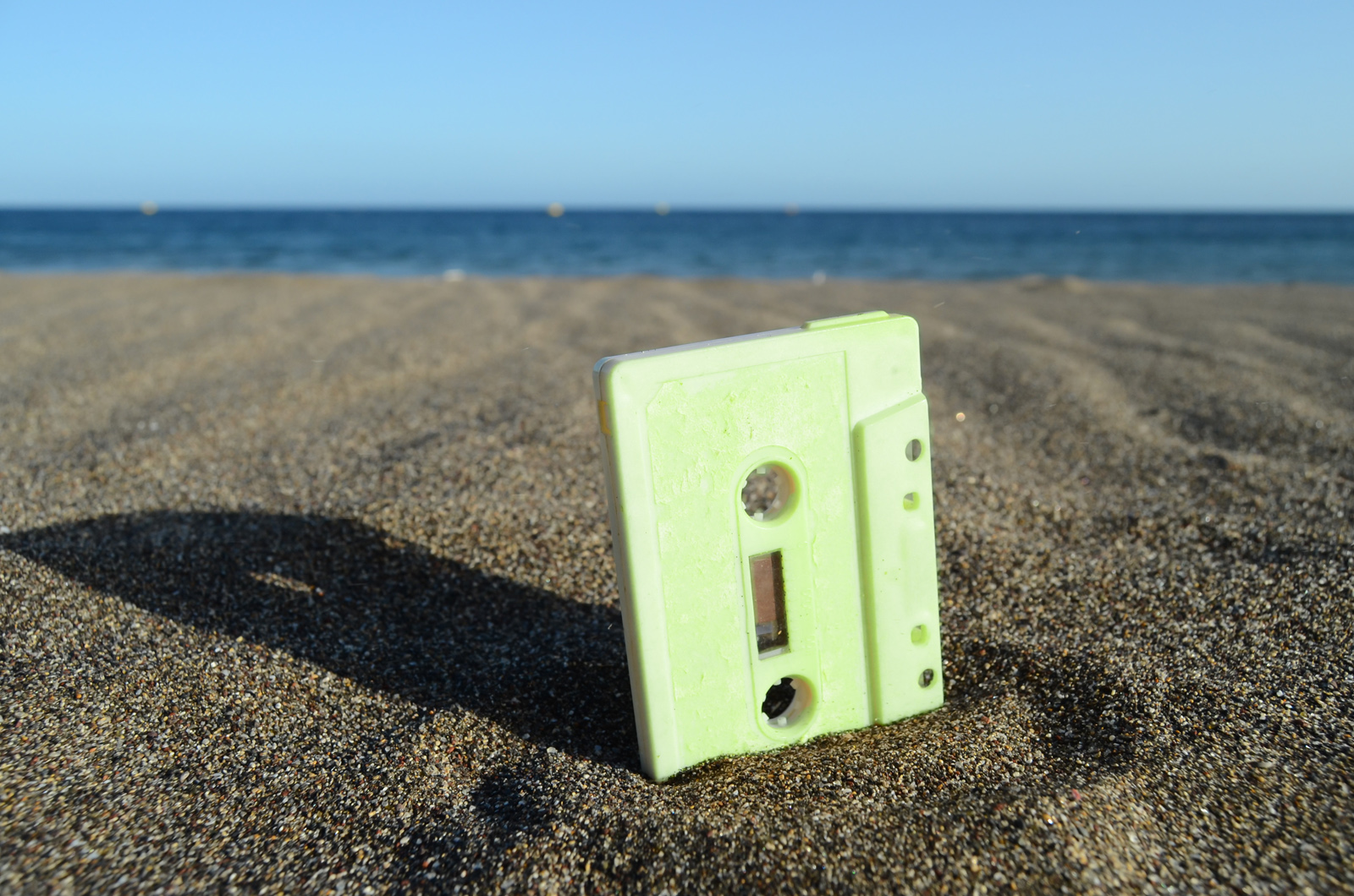 Audio cassette tape in the sand